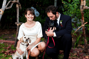couple and dog on their wedding day
